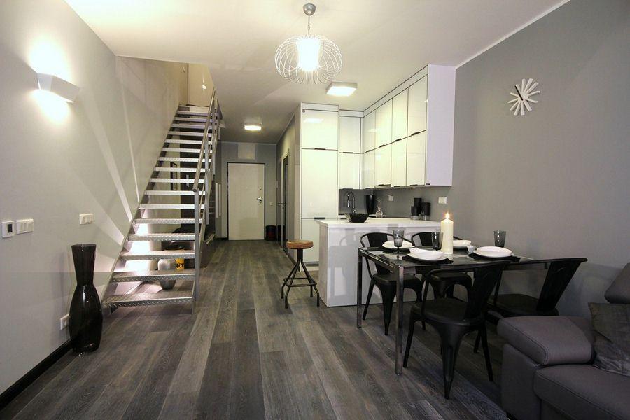 Jak urządzić salon z aneksem w loftowym stylu? To nasz pomysł na to wnętrze.