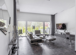Big window in trendy grey living room interior of suburban house