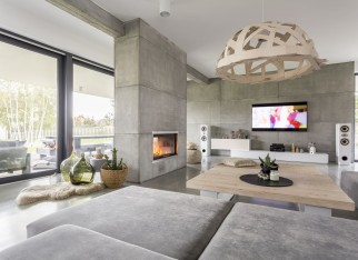 Spacious cozy living room with big windows and fireplace