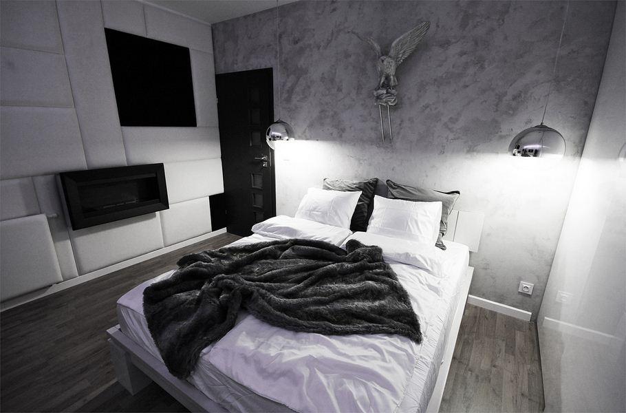 Beton na ścianie w sypialni to doskonały pomysł. Zobacz, jak osiągnąć taki efekt.