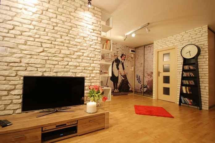 Czy nowoczesny salon może być tłem dla klasycznych dodatków? Zobacz nasz pomysł na aranżację tego wnętrza.