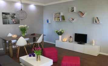 Podoba ci się ten eklektyczny salon? Zobacz więcej zdjęć tej aranżacji.