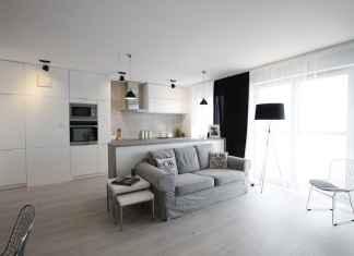 Zobacz nasz pomysł na salon z aneksem kuchennym w biało-szarej kolorystyce.