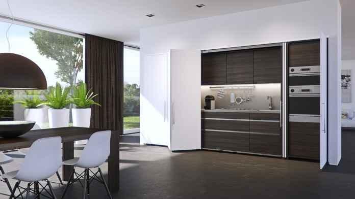 Kuchnia schowana za składanymi drzwiami to bardzo popularny rodzaj mebli kuchennych.
