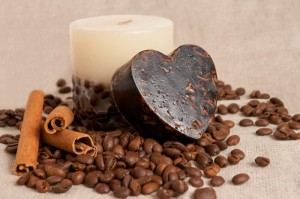 aroma handmade soap and candle and coffee beans on the canvas