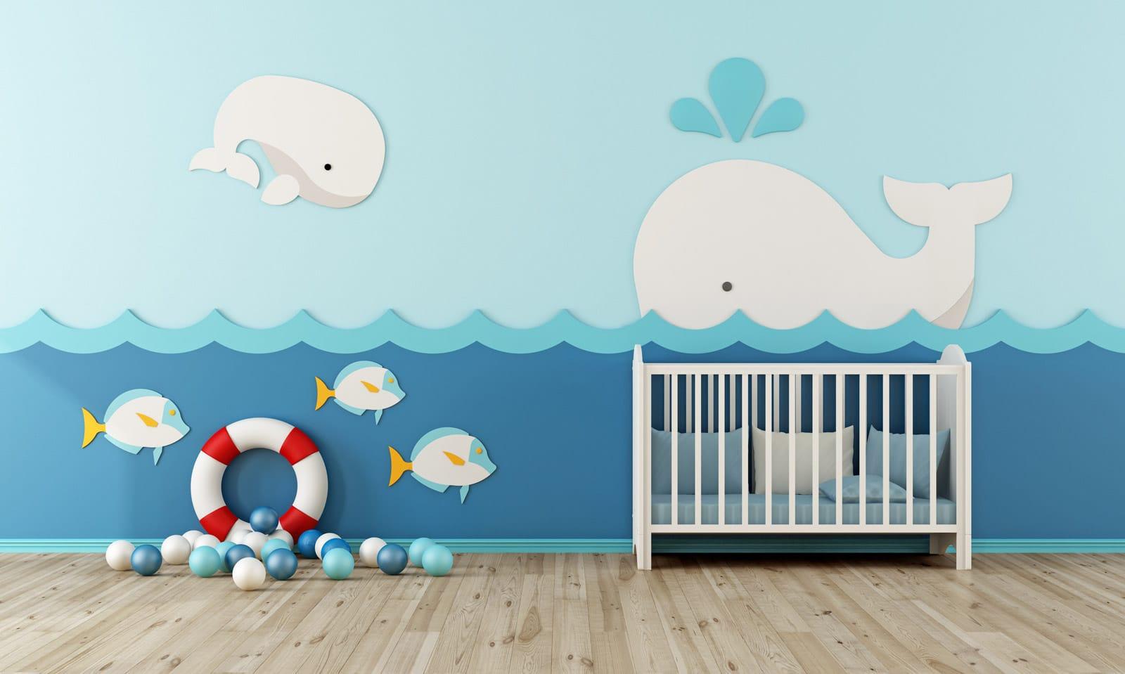 Niebieski pokój niemowlaka w delfiny